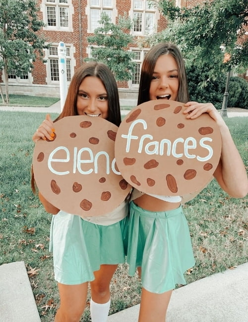 Two sorority women dressed up as girl scouts.